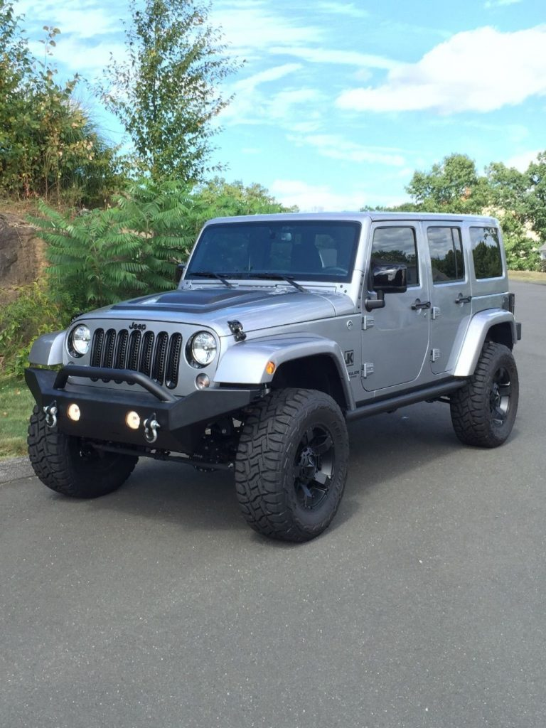 Very low miles 2015 Jeep Wrangler Altitude offroad