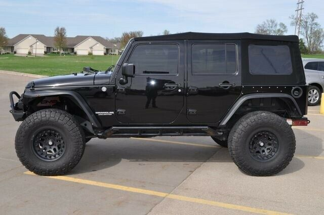 well modified 2015 Jeep Wrangler Sport offroad